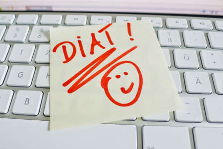thinness: a memo is on the keyboard of a computer as a reminder  diet