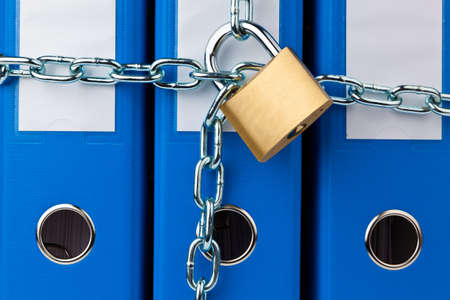 policies: a filing with chain and padlock closed  privacy and data security  Stock Photo