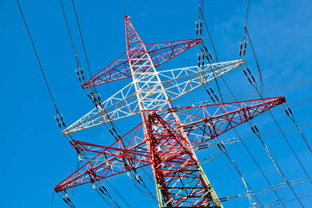 curren: a high voltage power line towers  production and transport of energy  Stock Photo
