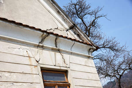 damaged roof: serious damage to the building of a house gable. unsafe building.