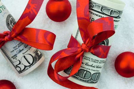 us dollars banknotes with ribbon as a cash gift for christmas