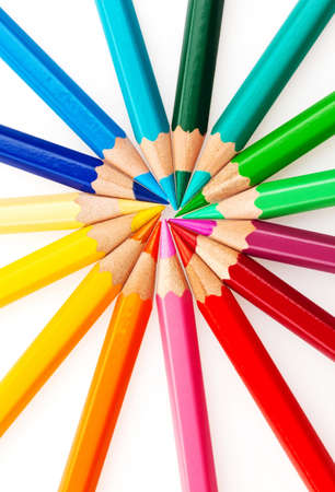 stationery needs: many different colored crayons on a white background. Stock Photo
