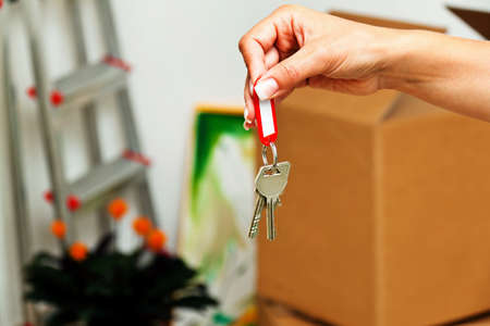 the key to an apartment with the move. new tenant moves. Stock Photo - 14359291