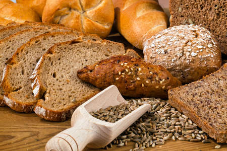several different types of bread. healthy diet with fresh baked goods. photo
