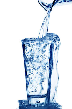 pure water: pure and clean water is poured into a glass. drinking water in the glass. Stock Photo