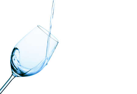 pure and clean water is poured into a glass. drinking water in the glass. photo