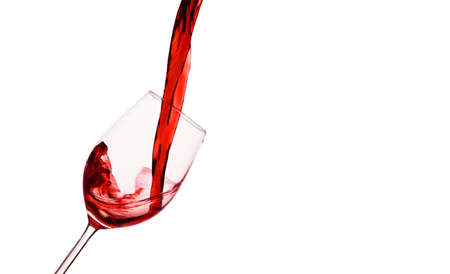 in a glass of red wine is lively empties. red wine in the wine glass photo