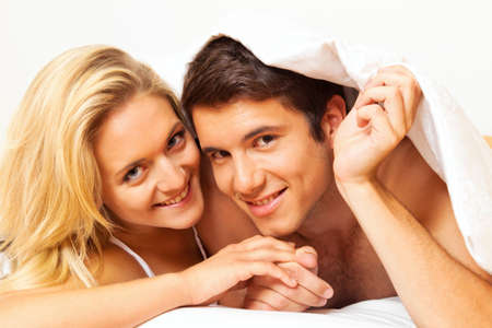 few: couple has fun in bed  laughter, joy and eroticism in the bedroom