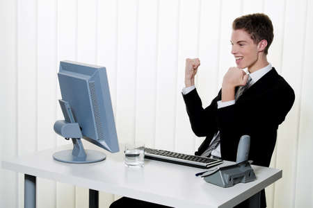 a successful young businessman at desk in office Stock Photo - 14337615