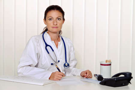 young doctor in her medical practice at the desk Stock Photo - 14337618