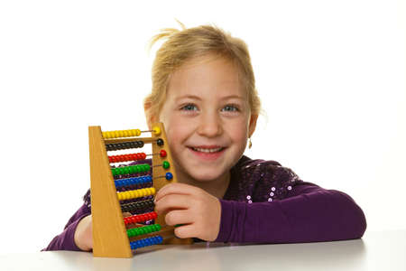 mathematically: a very young girl is expecting an abacus  Stock Photo