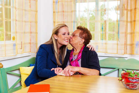 vivre: a grandson to visit his grandmother  hugs and kisses