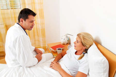 a physician house call  examines sick wife Stock Photo - 14337643