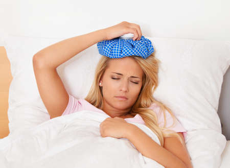 woman with ice pack for headaches and migraines Stock Photo - 14337624