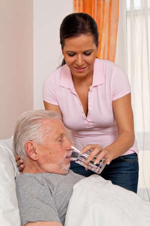 a nurse in aged care for the elderly in nursing homes Stock Photo - 14337655