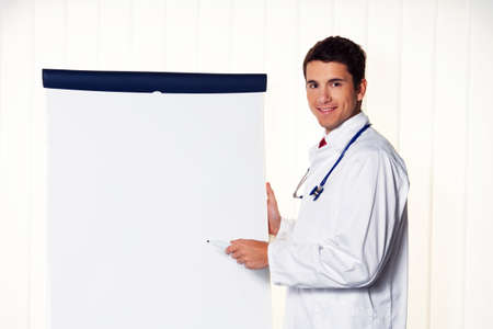 successful doctor with a flip chart during a presentation in meeting Stock Photo - 14337605