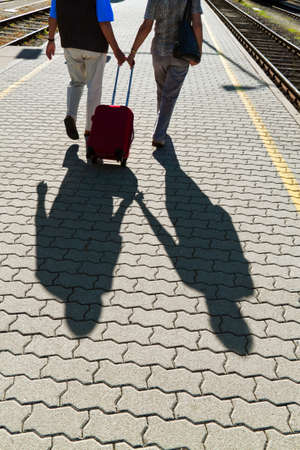 mature vital elderly couple at the railway station  travel on holiday photo
