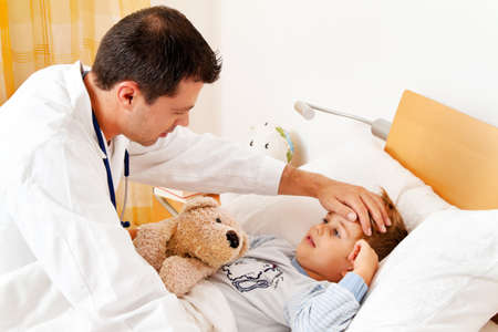 home visit: a physician house call  examines sick child