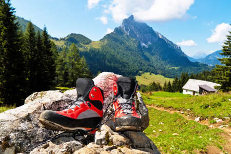 hillwalking: red hiking boots for a hike in the mountains of austria  activity during leisure time