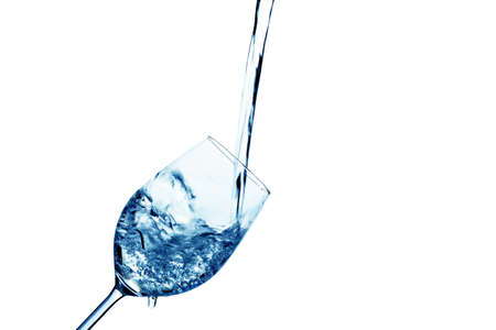 pure and clean water is poured into a glass  drinking water in the glass  photo