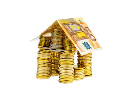 a house made of coins and banknotes  photo icon for house construction and home loans Stock Photo - 14414995