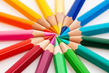 many different colored crayons on a white background  photo