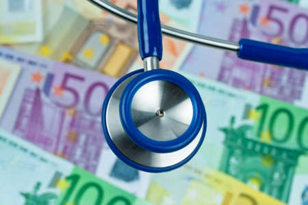 many euro bank notes with a stethoscope  health costs