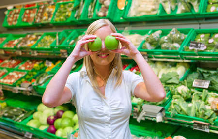 woman in the purchase of fresh fruits and vegetables in a supermarket shelf Stock Photo - 14488880
