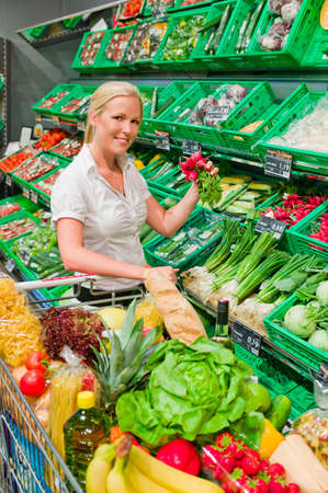 woman in the purchase of fresh fruits and vegetables in a supermarket shelf Stock Photo - 14498491
