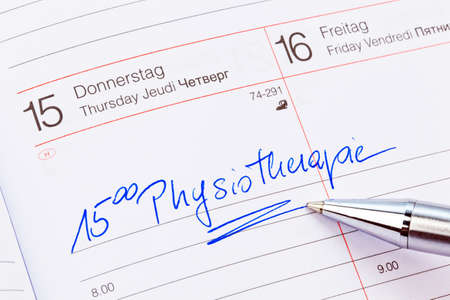 naturopaths: an appointment is entered on a calendar  physiotherapy Stock Photo