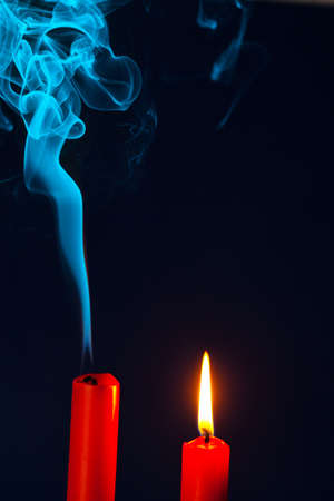 blow out: the flame of a candle was blown out  symbol of death, dying and past Stock Photo
