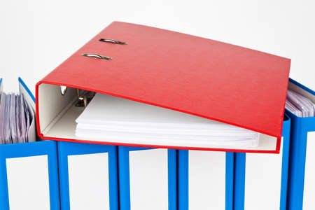 binders filled with documents and documents  retention of contracts  photo