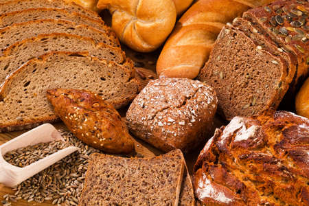 crusty french bread: several different types of bread  healthy diet with fresh baked goods