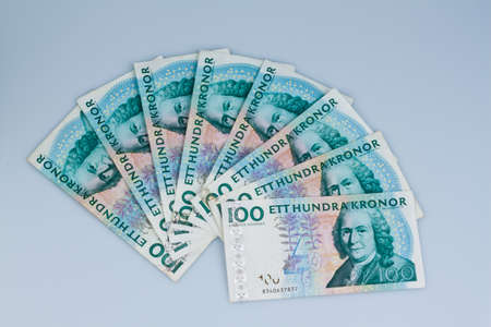 seem: swedish krona, the currency of sweden  lie next to each other as subjects  Stock Photo
