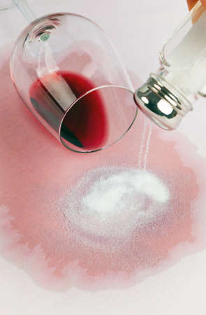 red wine stain: a glass of red wine was turned empty  tip of salt  Stock Photo