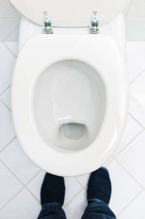 bowel movement: a sanitary flush toilet in a household  bathroom and toilet