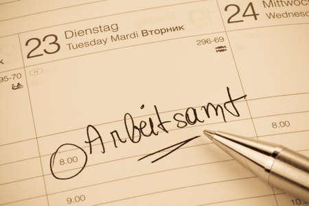 entlassen: an appointment is entered on a calendar  employment office
