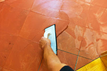 tile grout: a tile carries on to the floor tile grout  grouting of tiles