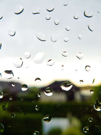 many rain drops during bad weather on a window pane  rainy weather Stock Photo - 14563467