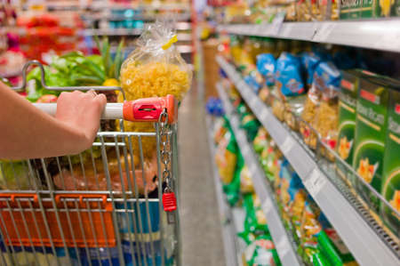 supermarket cart: a woman in the purchase of food in a supermarket  everyday life of a housewife