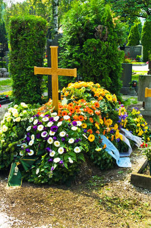 in a cemetery, a grave is fresh after a funeral  photo