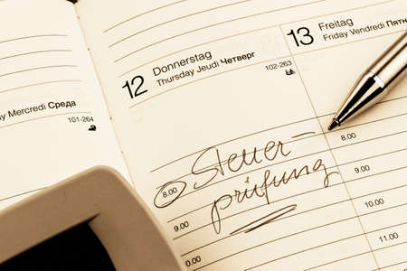 an appointment is entered on a calendar  tax audit Stock Photo - 14563557