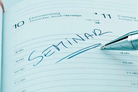 further: an appointment is entered on a calendar  seminar Stock Photo