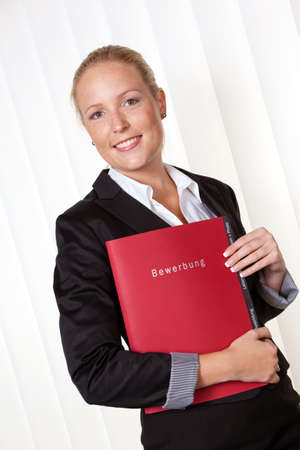 a woman in business attire with a job application  proper clothing for the interview  photo