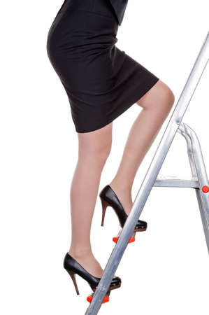 a woman climbs in the management of the career ladder  more women in senior positions Stock Photo - 14587272
