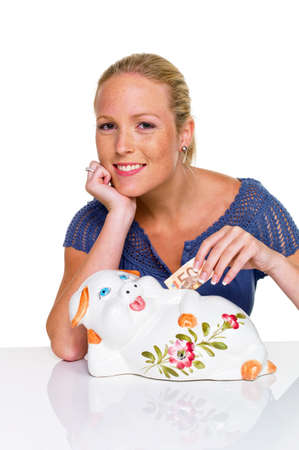 a young woman on a white background with a piggy bank  saving money as a pension  photo