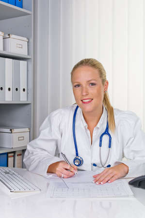 a young doctor with stethoscope in her doctor s office  Stock Photo - 14587312