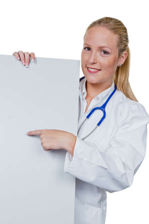 pracitioner: a young doctor with stethoscope in her doctor s office  holds an empty plate in hand Stock Photo