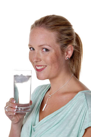 a young woman drinking a glass of fresh, clean water  refreshing mineral water and tap water Stock Photo - 14587336