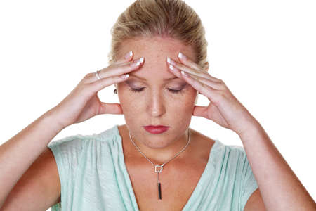 tenseness: a young woman with migraines and headaches  isolated against a white background Stock Photo